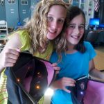 In learning about circuitry, the science of electricity, and customer-centric design, Lacy (l) and Madeleine, grades 4 and 5, created an interior-lit backpack. The STEAM workshop in which they participated, Textiles + TechStyles, was made possible with funding from the OtterCares Foundation.