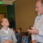 Laprele Zeller, grade 6, fields questions about her design from OtterCares Executive Director Gary Rogers. After conducting interviews at a local shelter, Laprele created an emergency alert backpack for the homeless. The 11-year-old was a participant in Textiles + TechStyles2, a Pretty Brainy workshop in which middle and high schoolers learn design thinking and how to code in the Arduino programming environment. photo: Shanthini Ode
