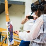 Girl in VR goggles painting