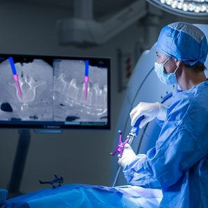 Surgeons utilize Medtronic's computer-aided design engineering technology, surgical navigation tools, during an operation.