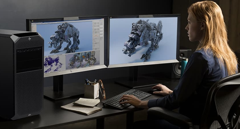 Woman using a work station for computer aided design